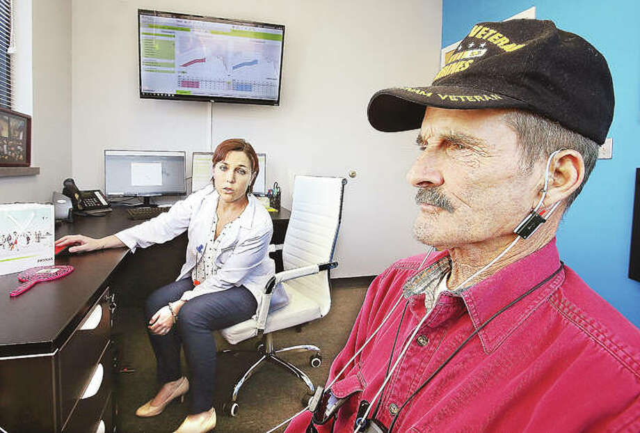 U.S. Marine Corps Vietnam Veteran Richard Sparks of East Alton gets fitted for a hearing aid this week by Dr. Chelsea Steer, Au.D., at the Mid America Audiology Group's new offices at 3511 College Ave. in Alton. Photo: John Badman|The Telegraph