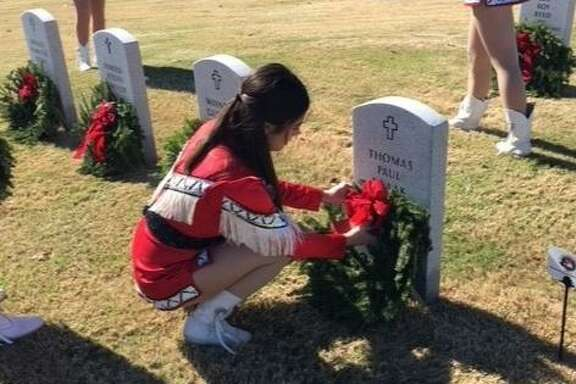 The Cleveland High School Indianettes visited the Houston National Cemetery to lay reefs on fallen soldiers graves on Dec. 15.