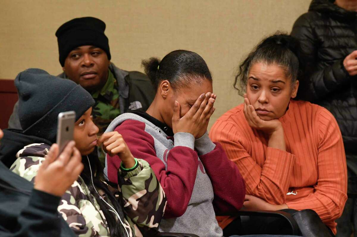 Community members who are not satisfied with the grand jury report clearing an Albany police officer of wrong doing in the Ellazar Williams police shooting react during a community forum at the Howe Branch library in Albany, N.Y., Wednesday, Dec. 19, 2018.
