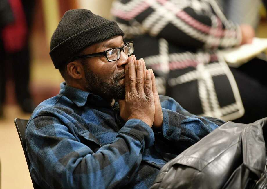 Community members who are not satisfied with the grand jury report clearing an Albany police officer of wrong doing in the Ellazar Williams police shooting participate in a community forum at the Howe Branch library in Albany, N.Y., Wednesday, Dec. 19, 2018. Photo: Hans Pennink, Times Union / Hans Pennink