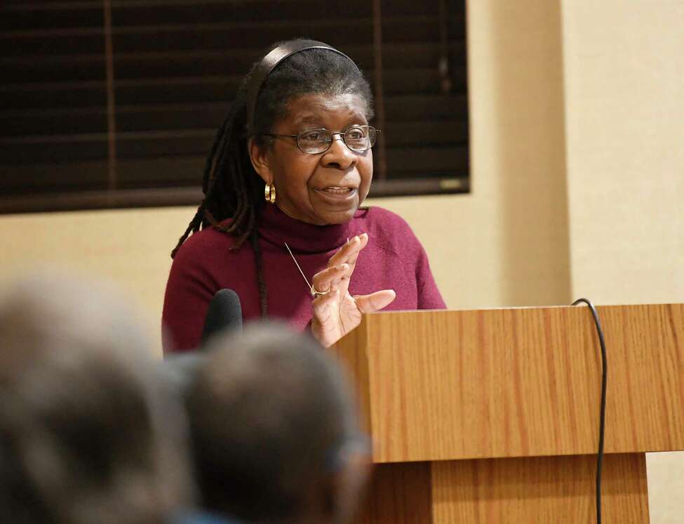 Dr. Alice Green Executive Director of the Center for Law and Justice, speaks with community activists who are not satisfied with the grand jury report clearing an Albany police officer of wrong doing in the Ellazar Williams police shooting during a community forum at the Howe Branch library in Albany, N.Y., Wednesday, Dec. 19, 2018.