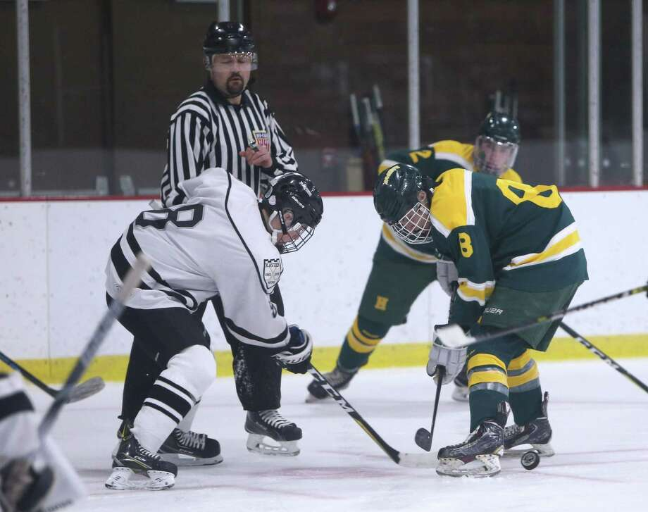 Xavier High School's Trevor Earley and Hamden High School's AJ Luedee square off during the boys varsity hockey game at Wesleyan University on Wednesday, Dec. 19, 2018. Photo: Emily J. Reynolds / For Hearst Connecticut Media / Connecticut Post Freelance