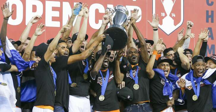 The Houston Dynamo celebrate after beating the Philadelphia Union 3-0 to win the 2018 Lamar Hunt U.S. Open Cup Final at BBVA Compass Stadium Wednesday Sept. 26, 2018 in Houston.