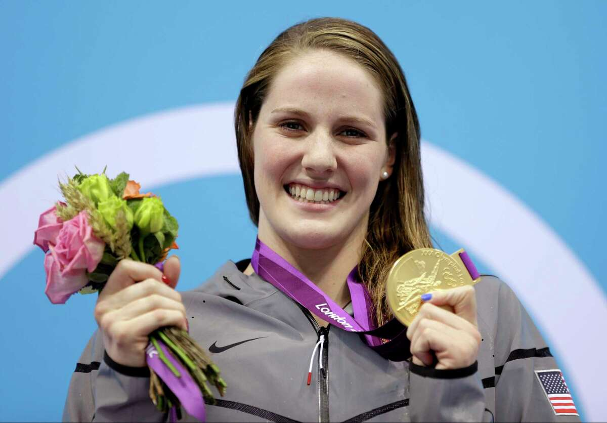 FILE - In this Aug. 3, 2012, file photo, United States' Missy Franklin holds her gold medal in the women's 200-meter backstroke final at the Aquatics Centre in the Olympic Park during the 2012 Summer Olympics in London. The five-time Olympic champion is retiring from swimming at age 23, citing chronic shoulder pain that has affected her for the last 2 and a half years. (AP Photo/Michael Sohn, File)