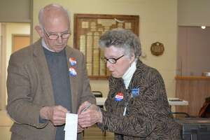 District 1 election moderator Clive Fuessenich confers with a poll worker Wednesday.