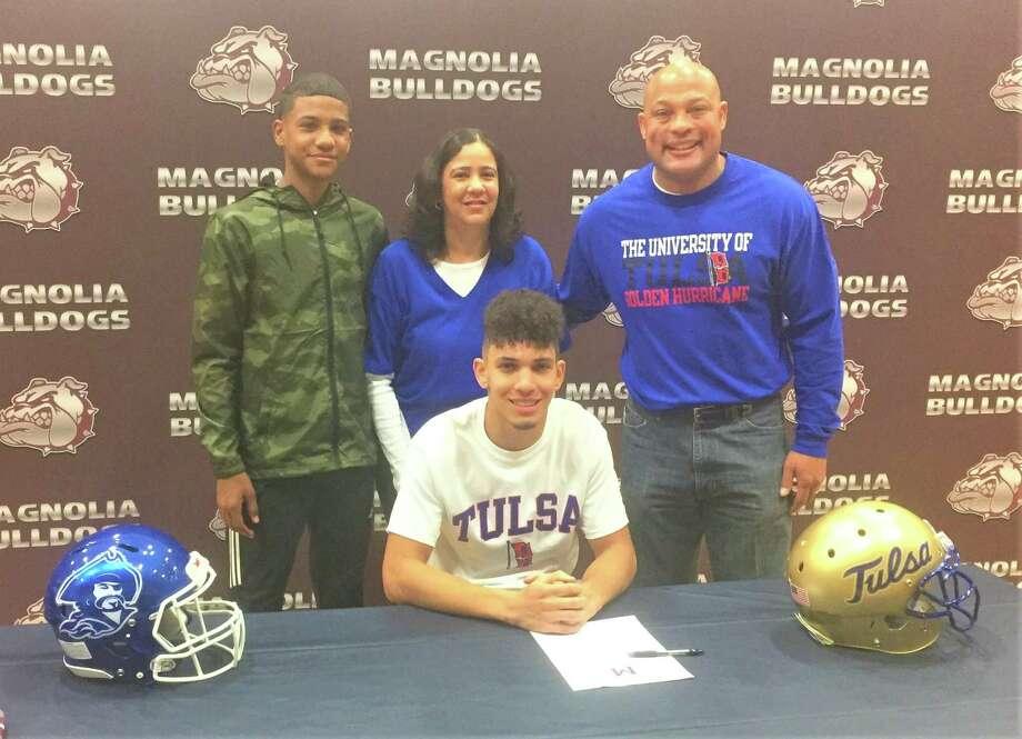 Mike Garrett Jr. signed with the University of Tulsa on Wednesday. Photo: Jon Poorman