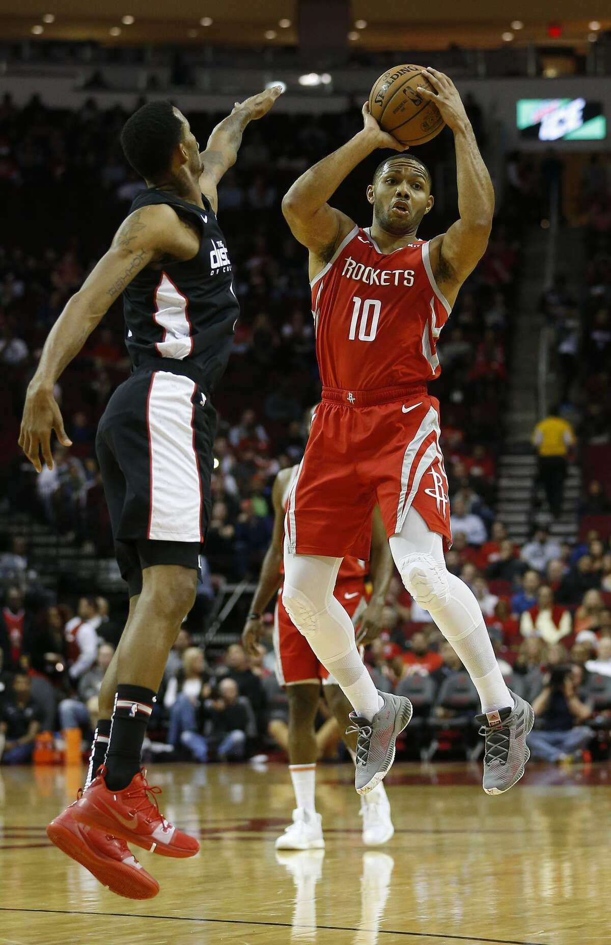 Houston Rockets guard Eric Gordon (10) passes the ball over Washington Wizards forward Trevor Ariza (1) during the first half of an NBA game at Toyota Center, Wednesday, Dec. 19, 2018, in Houston.