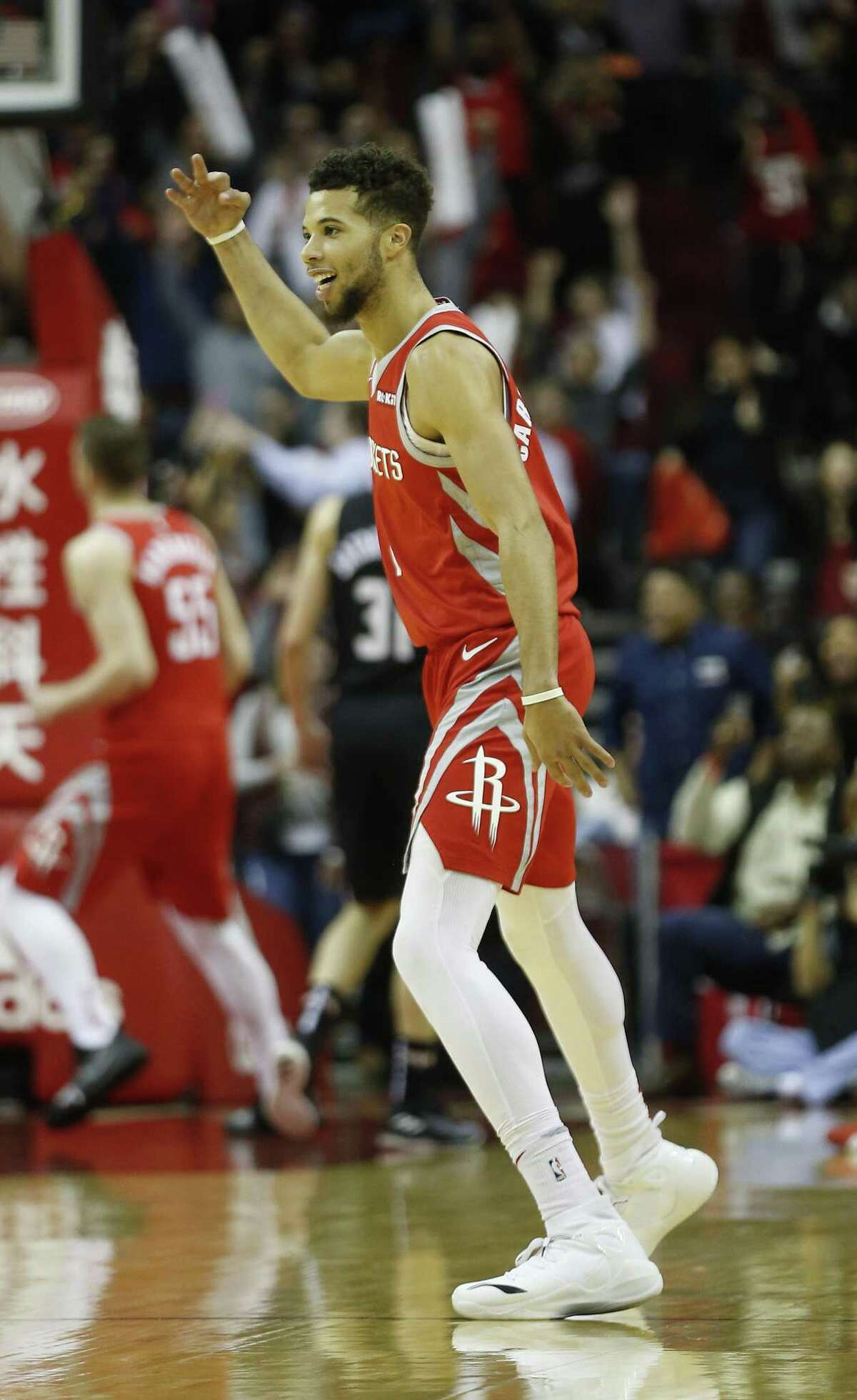 Rockets backup guard Michael Carter-Williams celebrates after his 3-pointer in the final seconds set the NBA record.