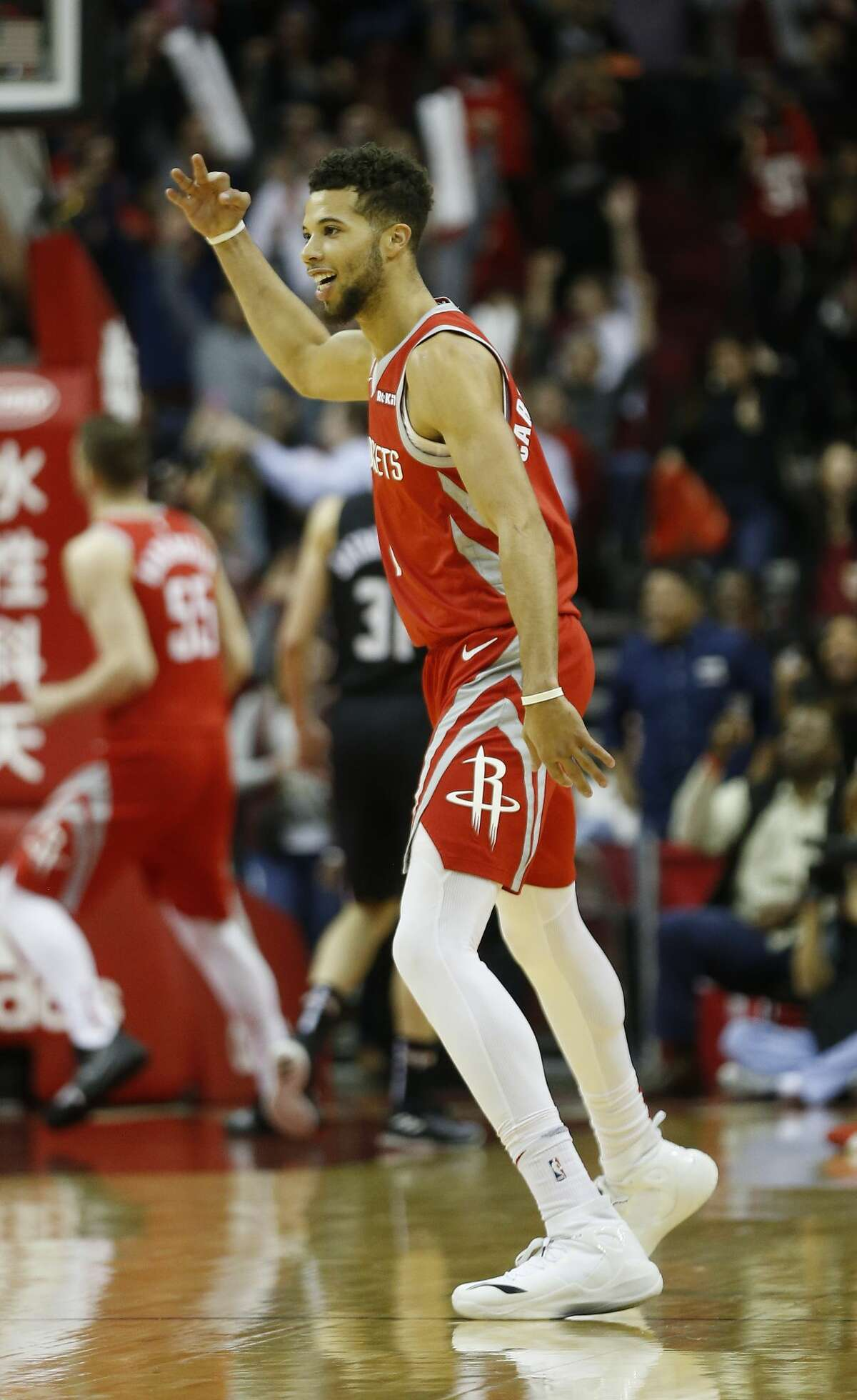 Houston Rockets guard Michael Carter-Williams (1) celebrates after his three-pointer in the final seconds during the second half of an NBA game at Toyota Center, Wednesday, Dec. 19, 2018, in Houston.