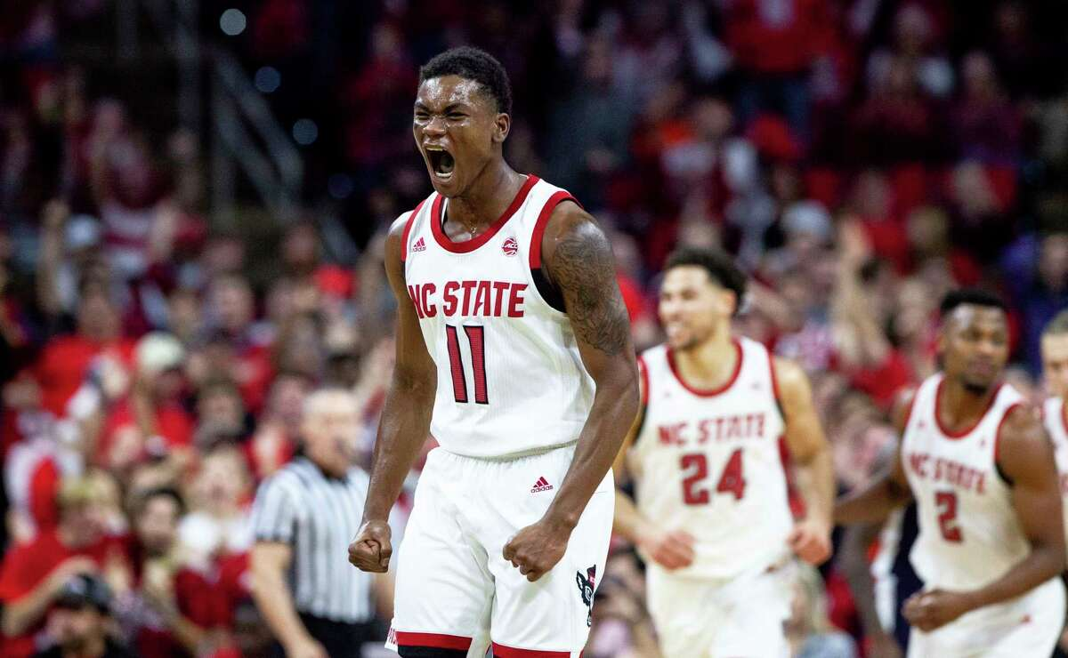 North Carolina State's Markell Johnson (11) reacts after hitting a three-point shot during the second half of an NCAA college basketball game against Auburn in Raleigh, N.C., Wednesday, Dec. 19, 2018. (AP Photo/Ben McKeown)