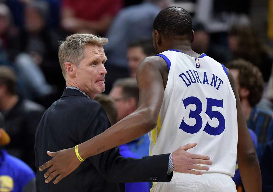 SALT LAKE CITY, UT - DECEMBER 19: Head coach Steve Kerr of the Golden State Warriors talks with his player Kevin Durant #35 in the first half of a NBA game against the Utah Jazz at Vivint Smart Home Arena on December 19, 2018 in Salt Lake City, Utah. NOTE TO USER: User expressly acknowledges and agrees that, by downloading and or using this photograph, User is consenting to the terms and conditions of the Getty Images License Agreement. (Photo by Gene Sweeney Jr./Getty Images) Photo: Gene Sweeney Jr. / Getty Images / 2018 Gene Sweeney Jr.