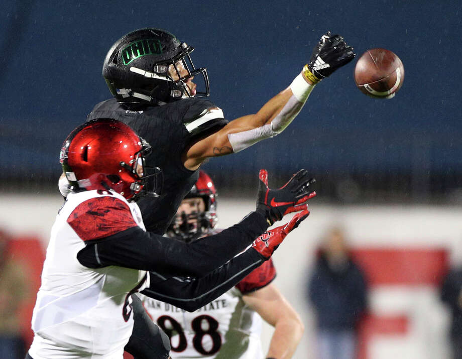 Ohio cornerback Marlin Brooks (22) breaks up a pass intended for San Diego State wide receiver Tim Wilson Jr. (6) in the first half of the Frisco Bowl NCAA college football game, Wednesday, Dec. 19, 2018, in Frisco, Texas. (AP Photo/Richard W. Rodriguez) Photo: Richard W. Rodriguez / Copyright 2018 The Associated Press. All rights reserved.