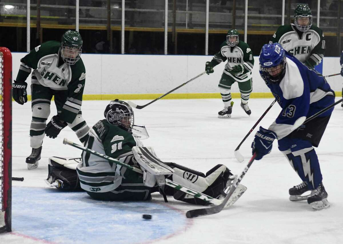 Saratoga forward Joe Amodio bats the puck in the goal past Shen goalie Kent Leighton during a game on Wednesday, Dec. 19, 2018 in Clifton Park, N.Y. (Jenn March, Special to the Times Union )
