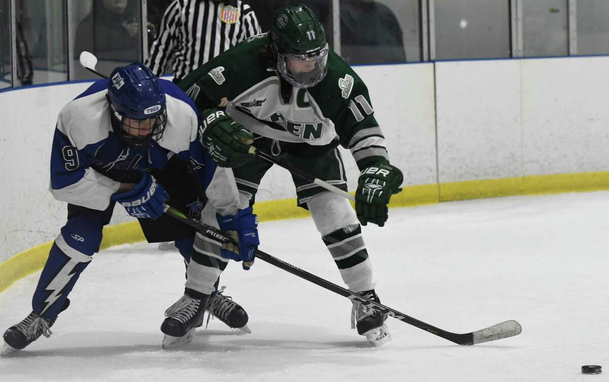Shen forward Brennan Alheim and Saratoga defenseman Quinn Leffler reach for the puck behind the Saratoga net during a game on Wednesday, Dec. 19, 2018 in Clifton Park, N.Y. (Jenn March, Special to the Times Union )