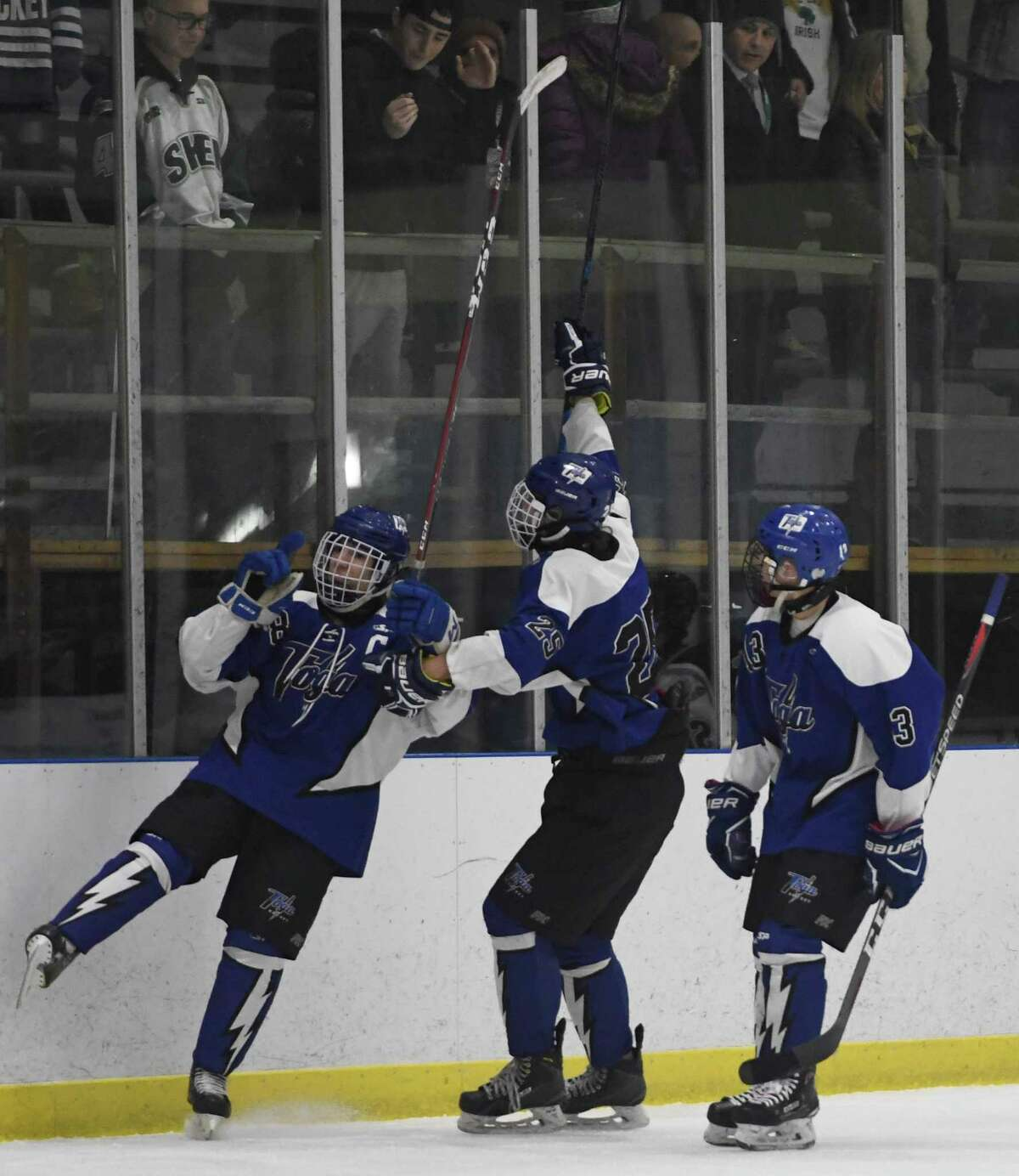 Saratoga varsity players skate by Shenendehowa fans following their first goal during a game on Wednesday, Dec. 19, 2018 in Clifton Park, N.Y. (Jenn March, Special to the Times Union )