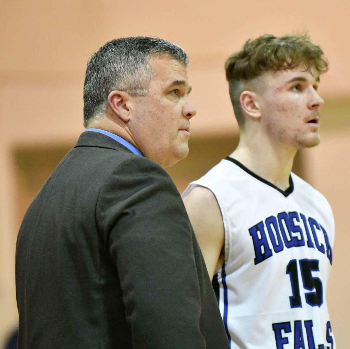Hoosick Falls head coach Mike Lilac talks to Max Kipp during a basketball game against Tamarac on Wednesday, Dec. 19, 2018 in Hoosick Falls, N.Y. (Lori Van Buren/Times Union)