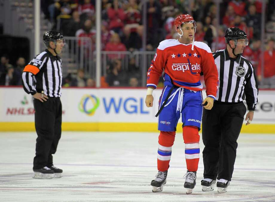 Tom Wilson is escorted to the penalty box in the first period. Photo   Washington 75927736a0c3