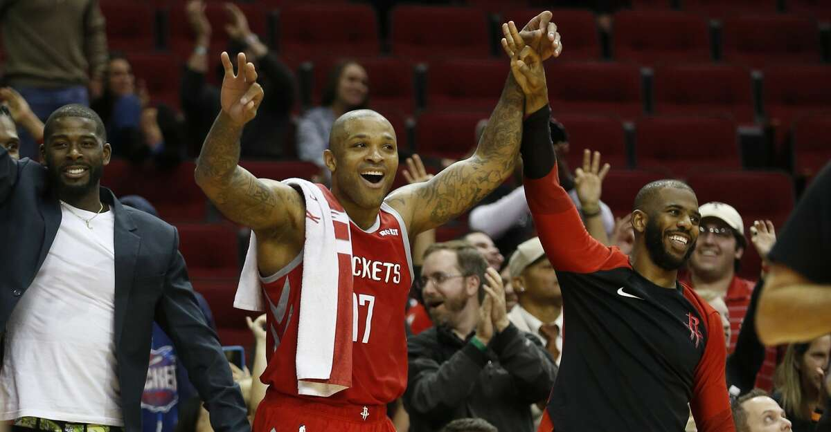 Houston Rockets forward PJ Tucker (17) and guard Chris Paul (3) celebrate on the bench after Michael Carter-Williams' three-pointer in the final second during the second half of an NBA game at Toyota Center, Wednesday, Dec. 19, 2018, in Houston.