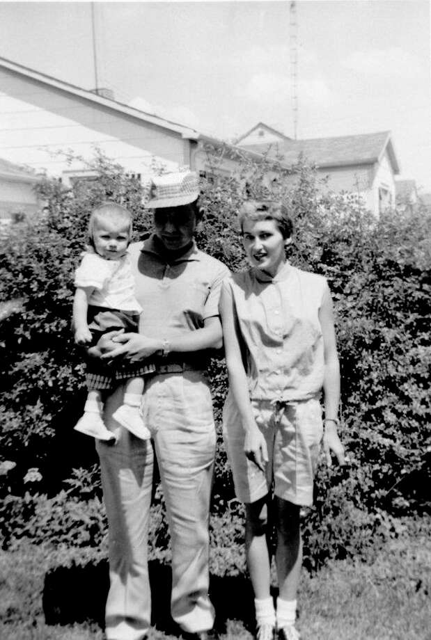 Bill and Joyce (Clerc) Miller pose for a snapshot with their first son, Steve. Later a brother named Brook joined the family. Steve remembers when they lived in a trailer park. He said, 'There was a long road leading into the trailer park that became a mud bog when it rained. Shorty's Wrecker Service was out there all the time.'