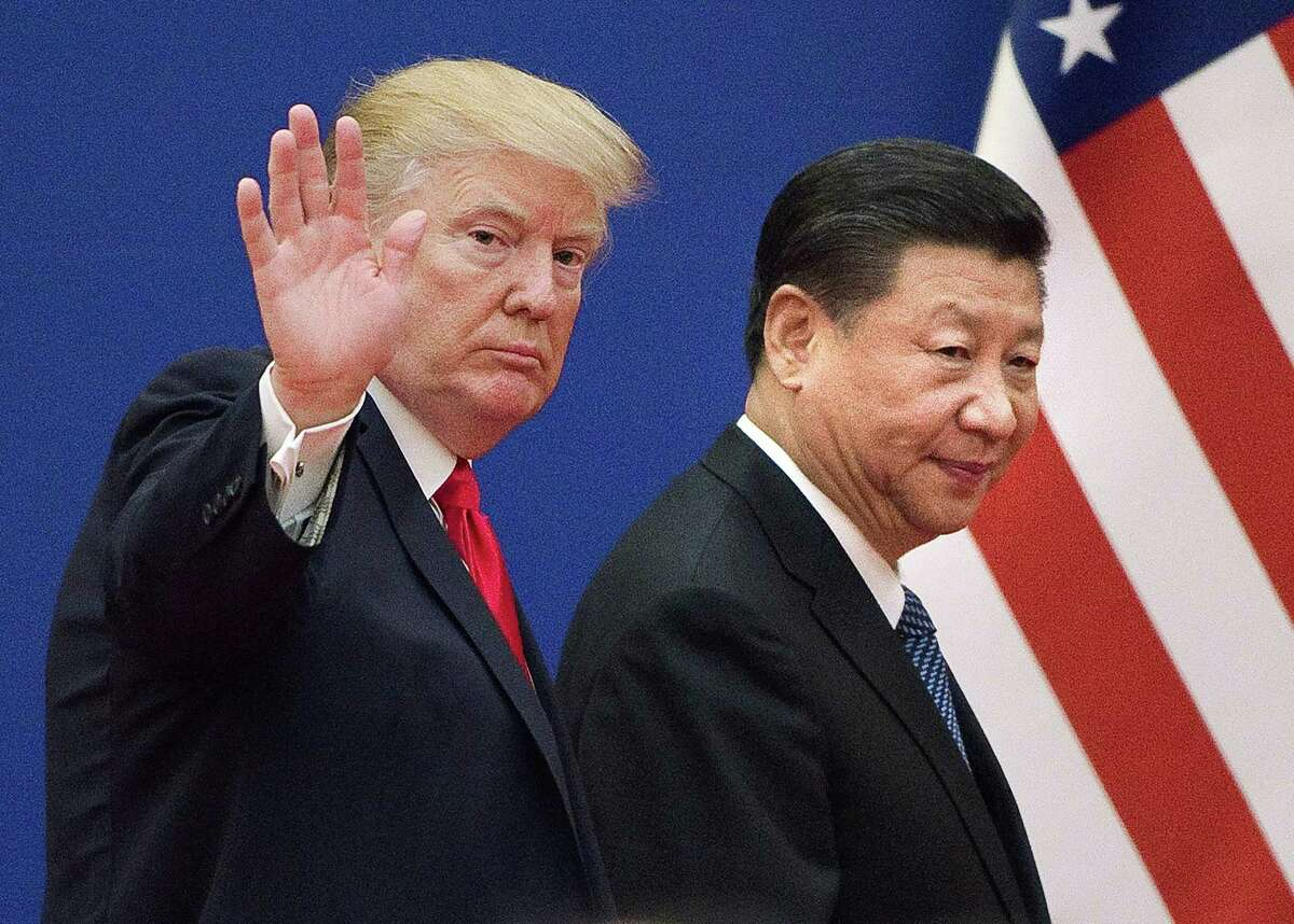 This file picture taken on Nov. 9, 2017, shows President Donald Trump and China's President Xi Jinping leaving a business leaders event at the Great Hall of the People in Beijing.