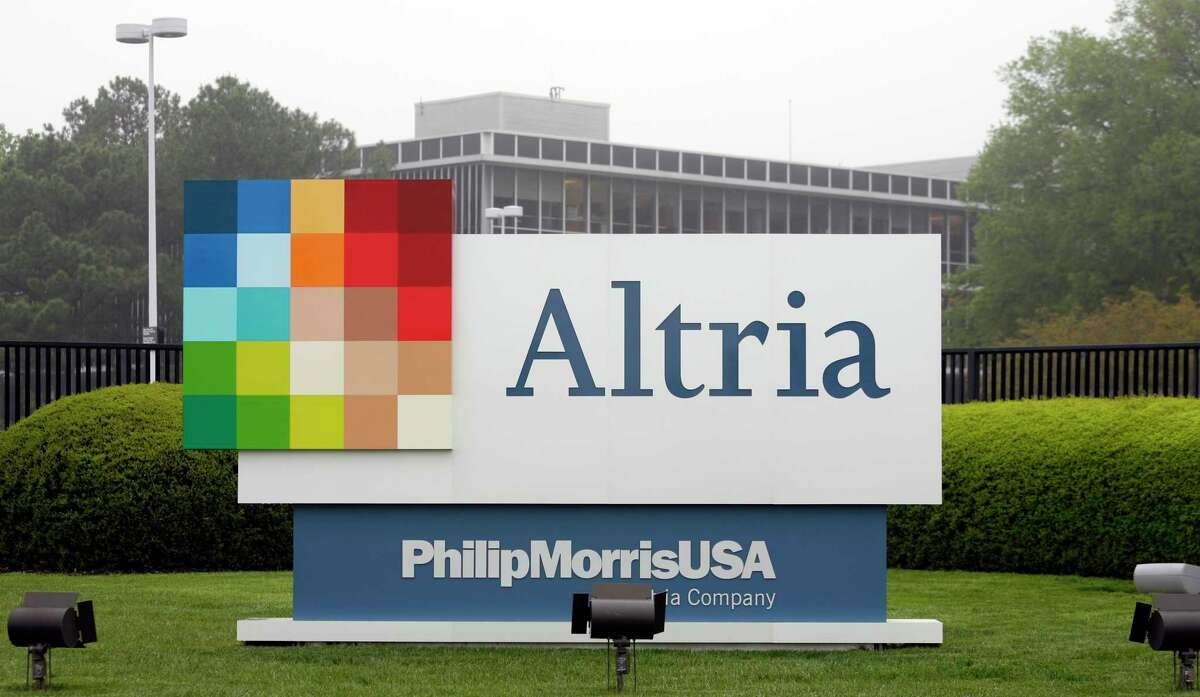 FILE - This April 23, 2008, file photo, shows the Altria Group Inc. corporate headquarters in Richmond, Va. Altria is spending about $12.8 billion for a stake in e-vapor company JUUL as one of the world's biggest tobacco companies tries to offset declining cigarette use.