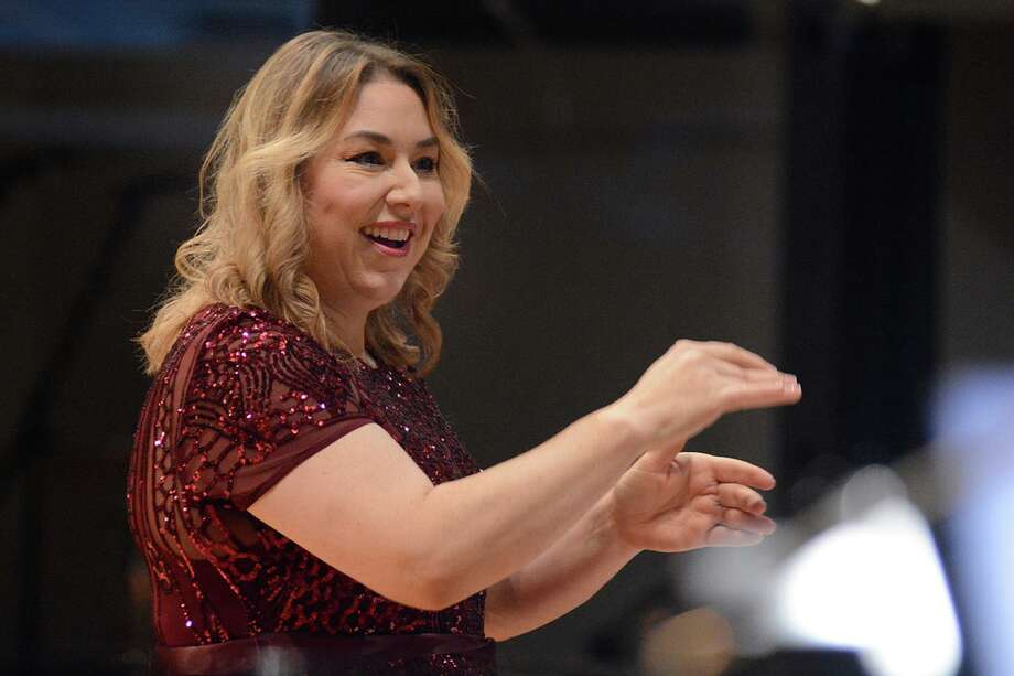 """Heather Orr, Artistic Director of MCCS, directs the Montgomery County Choral Society at its """"A Christmas Wish"""" concert in 2018. This year's holiday concert is themed """"White Christmas"""" and is set for Friday, Dec. 6. Photo: Photo By David Hopper"""