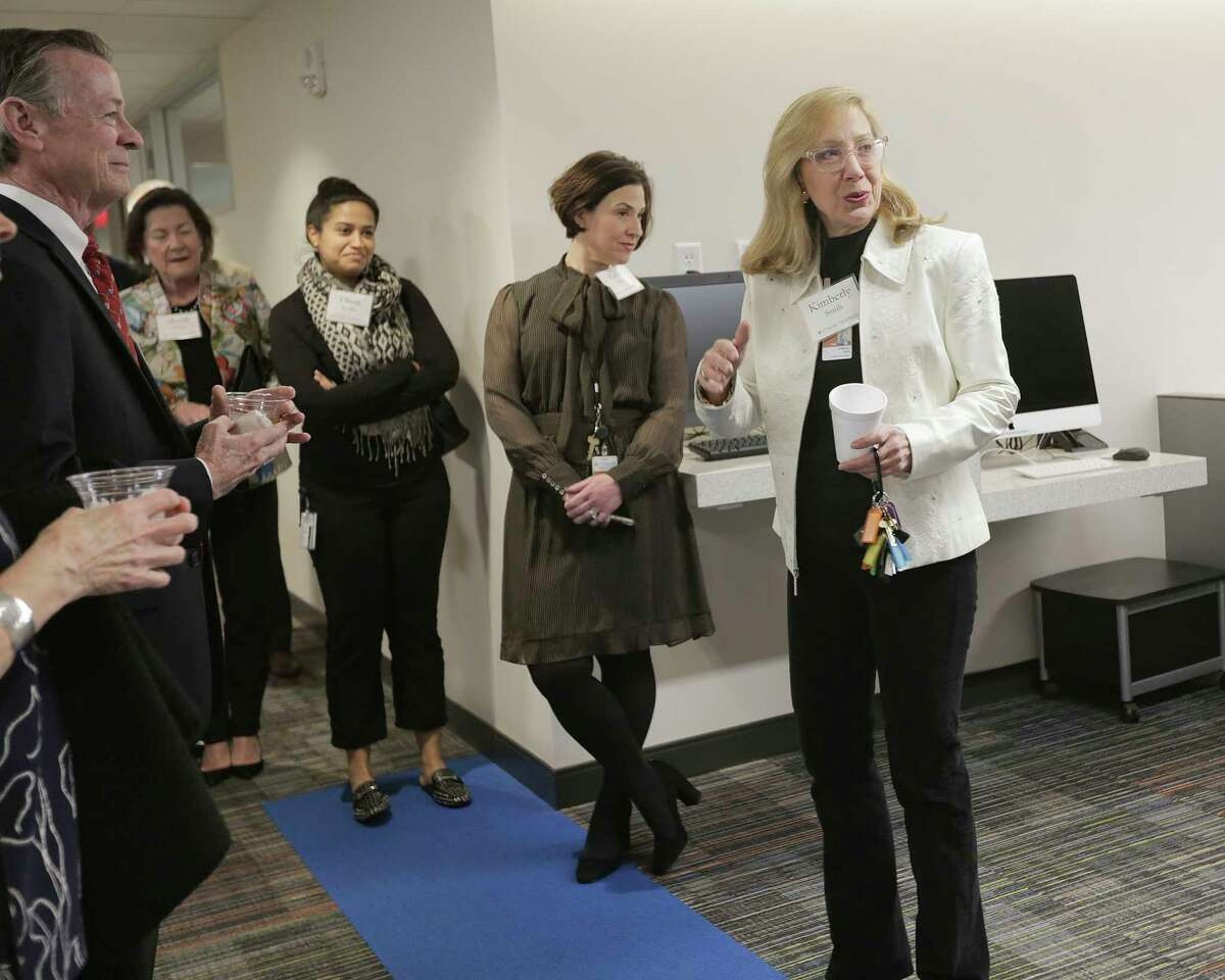 UTHealth School fo Biomedical Informatics faculty member and former PhD student Kimberly Smith gives a tour of the new $15 million building in Houston on Wednesday, Dec. 19, 2018.