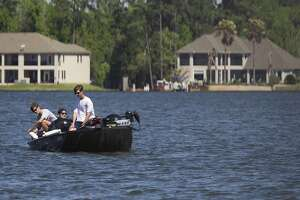 A family boats along Lake Conroe after the San Jacinto River Authority reopened Lake Conroe Saturday, March 31, 2018. Officials urged boaters to use extreme caution due to floating debris and submerged objects that are not be fully visible.