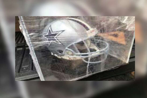 Cowboys signed helmet in display box Photo: Court Documents