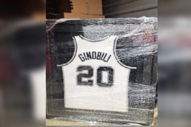 Framed Spurs autographed jersey of Ginobili Photo: Court Documents