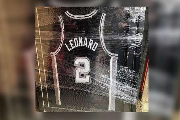 Framed Spurs autographed jersey of Leonard Photo: Court Documents