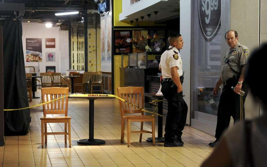 Security guards stand near the closed food court at the Westfield Trumbull Mall after a portion of the roof collapsed on Saturday, July 17, 2010. Photo: Lindsay Niegelberg
