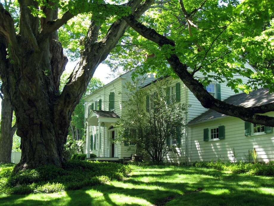The almost 3,700-square-foot, nine-room, 18th-century Ebenezer Smith home, framed by the biggest sugar maple in Connecticut, was partly remodeled at the turn of the 19th century into the Federal style, and a north wing was added later still. Photo: Contributed Photo / Stamford Advocate Contributed