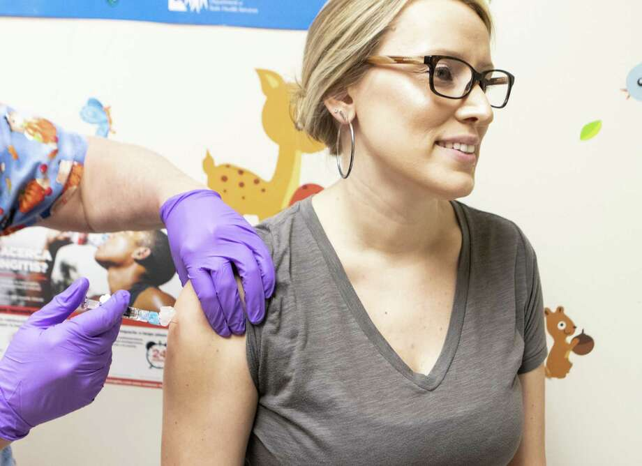 Emily Fitzgerald, Montgomery County Hospital District human resources manager, receives her flu shot from MCHD public health nurse Kim Shirley on Tuesday, Oct. 30, 2018 at the Montgomery County Public Health District clinic in Conroe Photo: Cody Bahn, Houston Chronicle / Staff Photographer / © 2018 Houston Chronicle