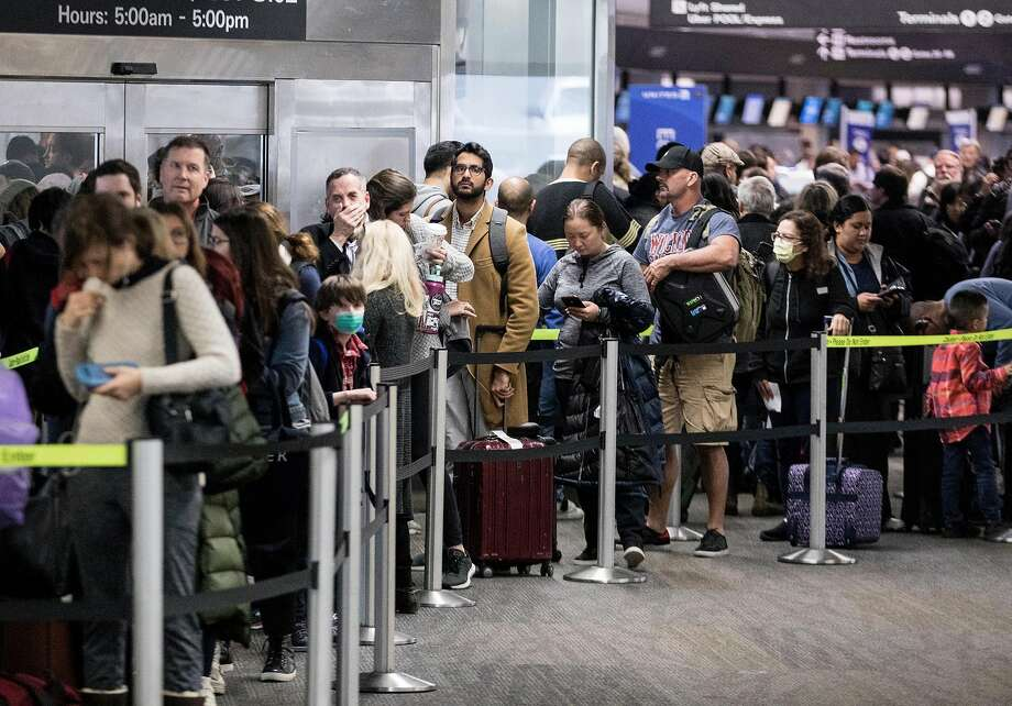 FILE PHOTO: Hundreds of passengers wait to go through a TSA security checkpoint before catching their flights at San Francisco International Airport in San Francisco, Calif. Wednesday, Dec. 19, 2018. Photo: Jessica Christian / The Chronicle 2018