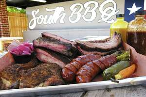 Smoked chicken, sausage, St. Louis pork ribs and brisket with pickled onions, carrot and jalapeño from South BBQ & Kitchen.