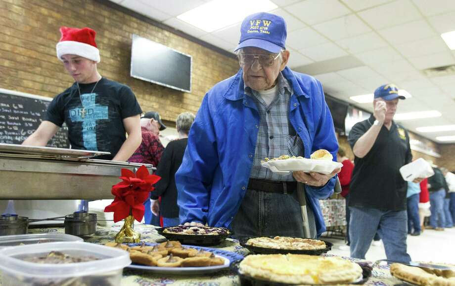 Duane Scott, a World War II veteran who served in the Philippines, leads the lunch line during the annual Conroe Veterans of Foreign War Post 4709 Christmas Day lunch, Monday, Dec. 25, 2017, in Conroe Photo: Jason Fochtman, Staff Photographer / Houston Chronicle / © 2017 Houston Chronicle