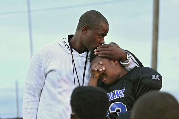 Coach Damin Waring comforts player Diamond Williams during a practice on Oct. 3, 2018, following the death of the team's coach, Joseph Davis. Davis was team's second coach to be killed in 2018. Elijah Cancer was a volunteer coach. Both Davis and Cancer had sons on the team.(Lori Van Buren/Times Union)