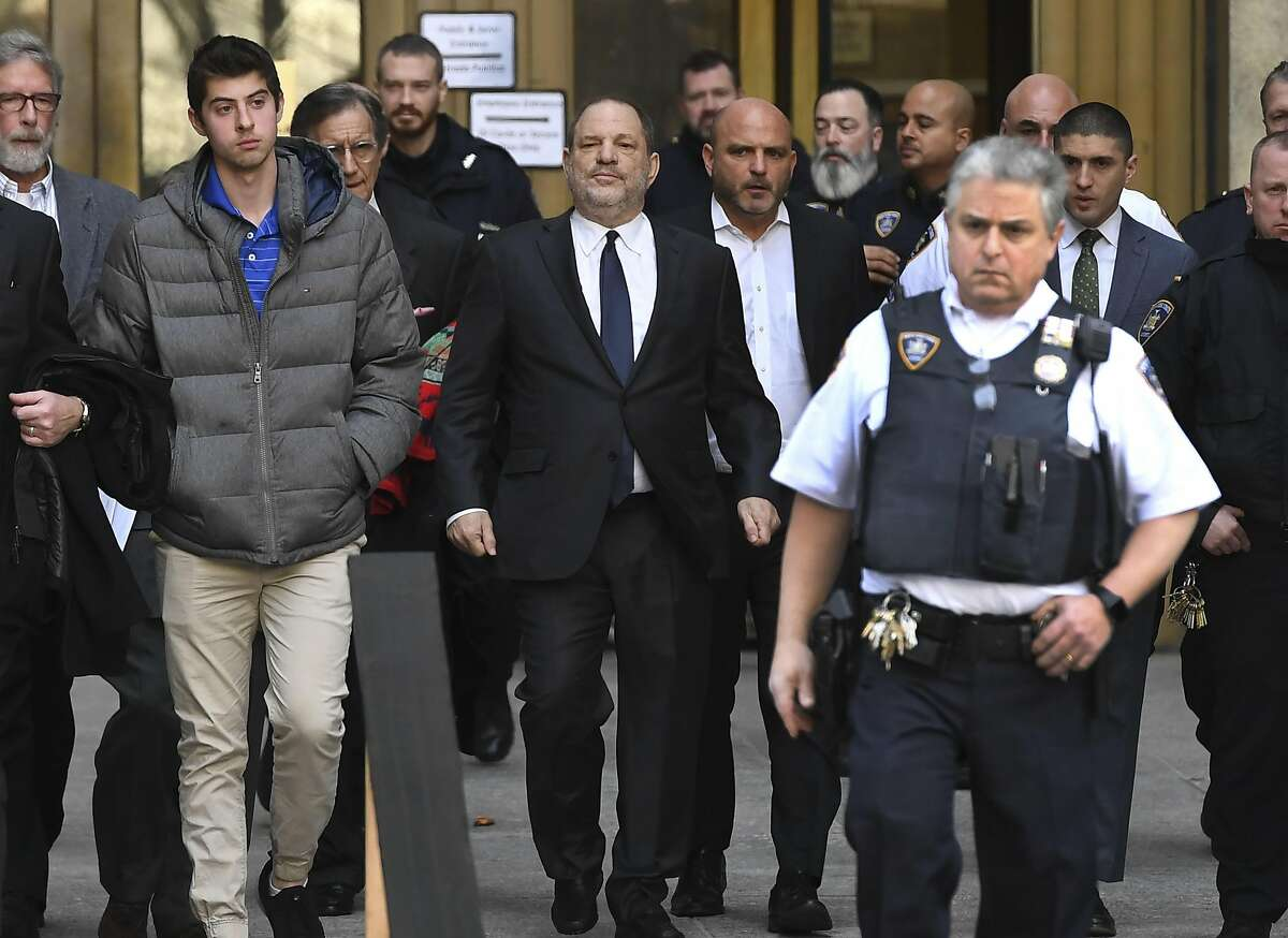 """Movie producer Harvey Weinstein(C) departs Manhattan Supreme Court in New York with his lawyer Benjamin Brafman in New York on December 20, 2018, after a hearing on whether to grant or deny a motion to drop criminal sex assualt charges against Weinstein. - A US judge on Thursday refused to dismiss sexual assault charges against disgraced movie mogul Harvey Weinstein, and set the next hearing in the case for March.""""We are obviously disappointed that the charges were not dismissed today,"""" Weinstein's attorney Ben Brafman told reporters after a brief court hearing in Manhattan.Judge James Burke set the next hearing in the case for March 7.Weinstein, public enemy number one of the #MeToo movement, could face life in prison if convicted of the charges. (Photo by TIMOTHY A. CLARY / AFP)TIMOTHY A. CLARY/AFP/Getty Images"""