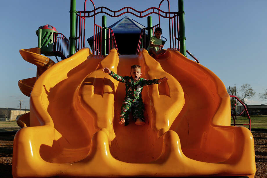 Ryland Ward plays with his aunt, Haley Ward, right, at La Vernia City Park. Photo: Lisa Krantz / San Antonio Express-News