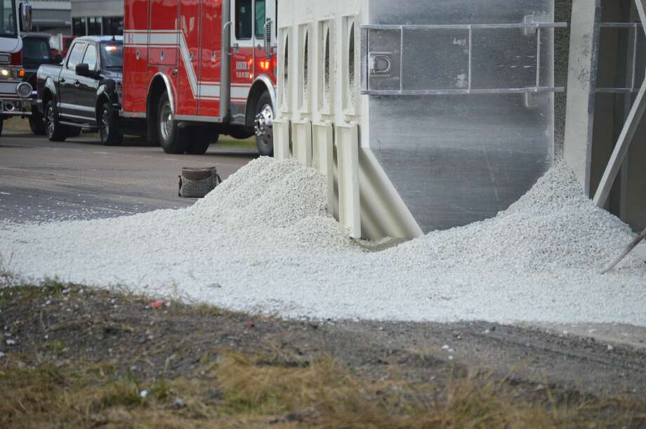 A tractor-trailer rolled over Thursday morning spilling gravel over the highway. Photo: Photo By: Eric Williams
