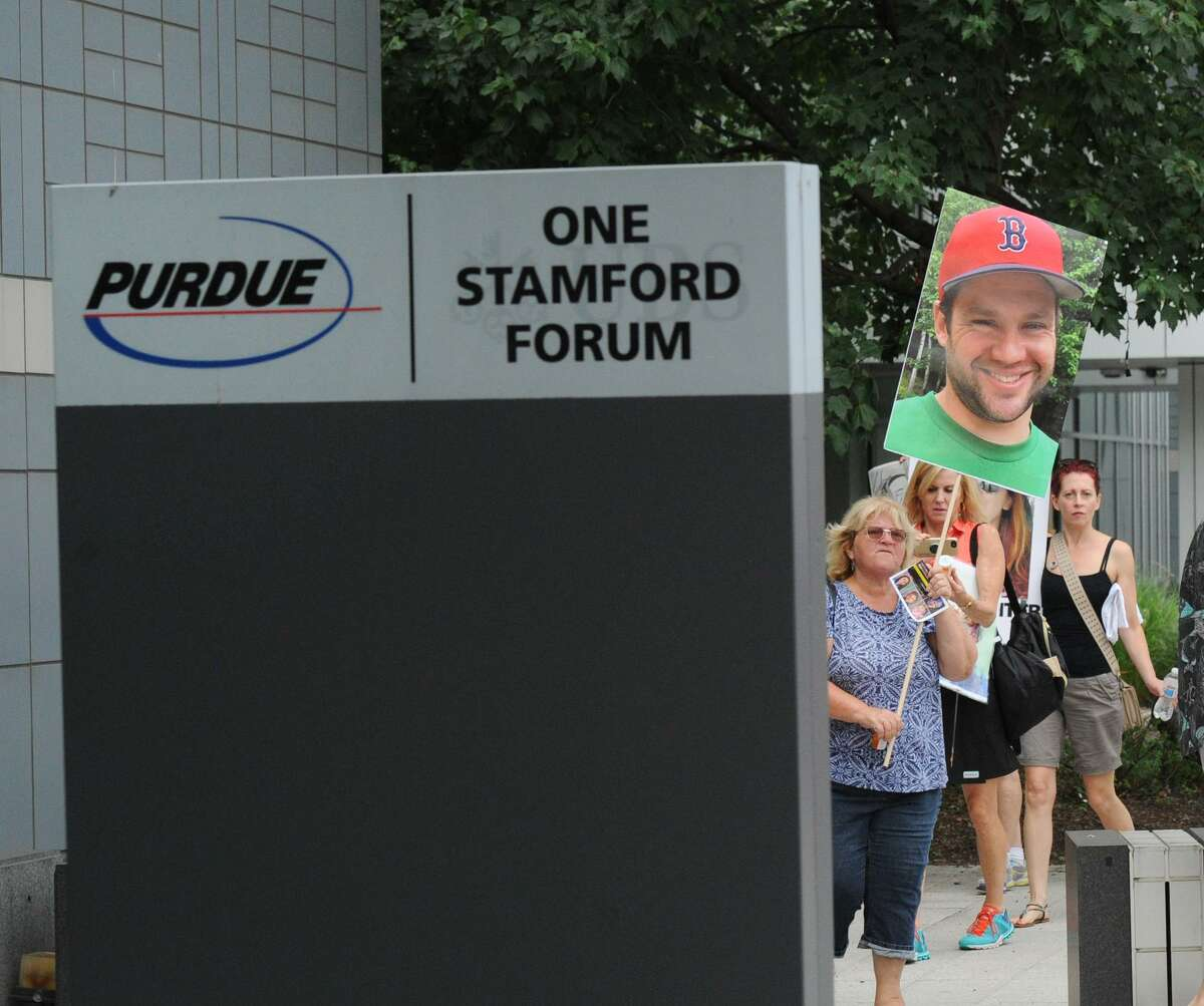 Protesters outside of Purdue Pharma's Headquarters in Stamford in August.