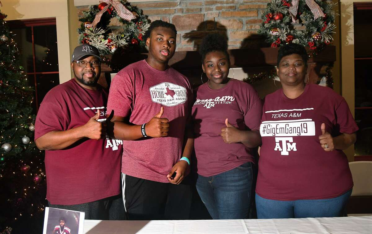 Kenyon Green, second from left, a senior and an offensive lineman at Atascocita High School, celebrates his signing with Texas A&M with his dad Henry Green, from left, his sister Kamirah, and his mom Sharonda at a signing ceremony at the Eagle Springs Clubhouse on Dec. 19, 2018.