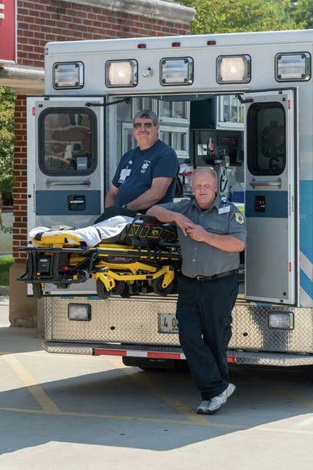 Rex Allen Book, left, and Dennis Eyer have been with Alton Memorial's EMS team since it started in 1988. Photo: For The Telegraph