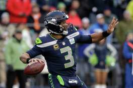 FILE - In this Dec. 2, 2018, file photo, Seattle Seahawks quarterback Russell Wilson passes against the San Francisco 49ers during the second half of an NFL football game, in Seattle. Kansas City plays at Seattle on Sunday, Dec. 23.