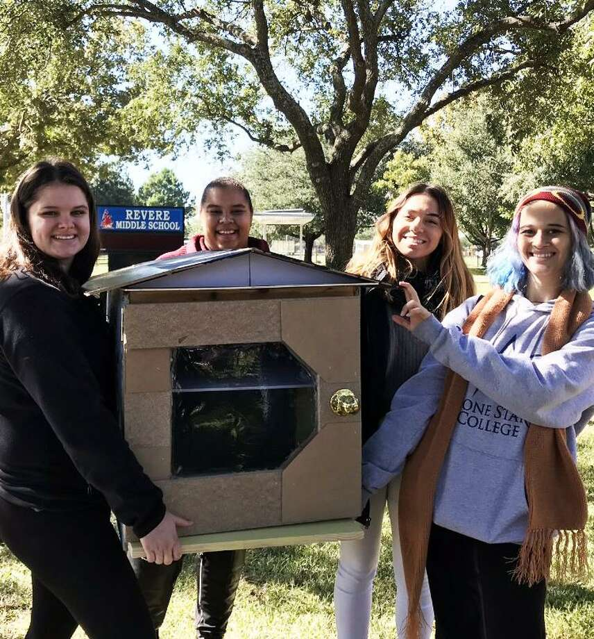 Lone Star College-CyFair students Alyssa Butler, Emily Barret, Destiny Burzynski and Angel Perez helped supply refugee communities with free books in mini-libraries. Photo: Lone Star College-CyFair