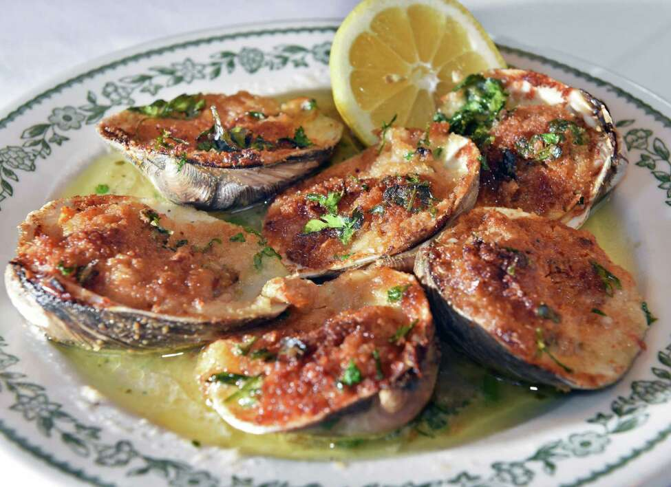The antipasti dish, Clams Oregenato, at Solevo Kitchen + Social is a classic interpretation with oregano, breadcrumbs and served with lemon. (John Carl D'Annibale/Times Union)