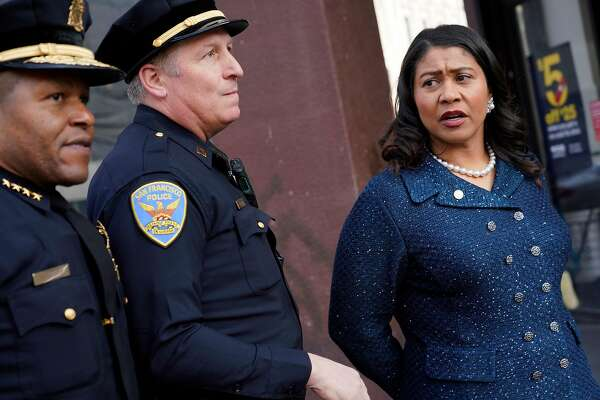 """Mayor London Breed (right), San Francisco Police Chief Bill Scott (left) and Captain Carl Fabbri (center) look down Market Street while out walking with a Healthy Streets Operation Center team in a new program called �Healthy Streets Intervention"""" on Wednesday, November 14, 2018 in San Francisco, Calif."""