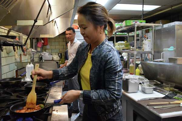 Jinah Kim, owner of Sunhee's Farm Kitchen and Restaurant in Troy works in the kitchen with Hamid Razai, 38, from Afghanistan, on Dec. 13, 2018 in Troy, N.Y. Most of her kitchen staff are refugees or immigrants.
