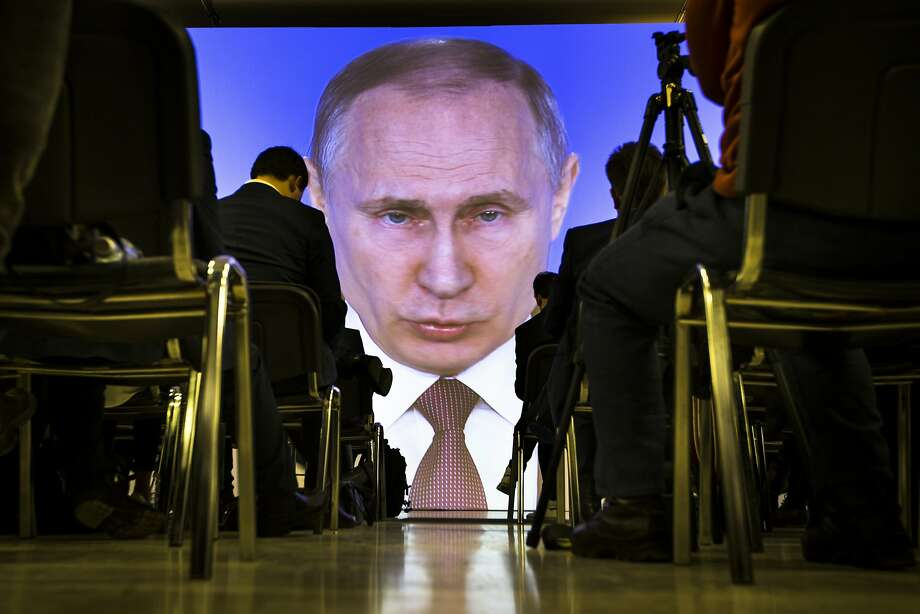 Journalists watch as Russian President Vladimir Putin gives his annual state of the nation address in Manezh in Moscow, Russia, on March 1, 2018. (AP Photo/Alexander Zemlianichenko) Photo: Alexander Zemlianichenko, Associated Press